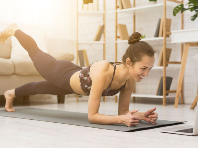 Girl,Training,At,Home,,Doing,Plank,And,Watching,Videos,On
