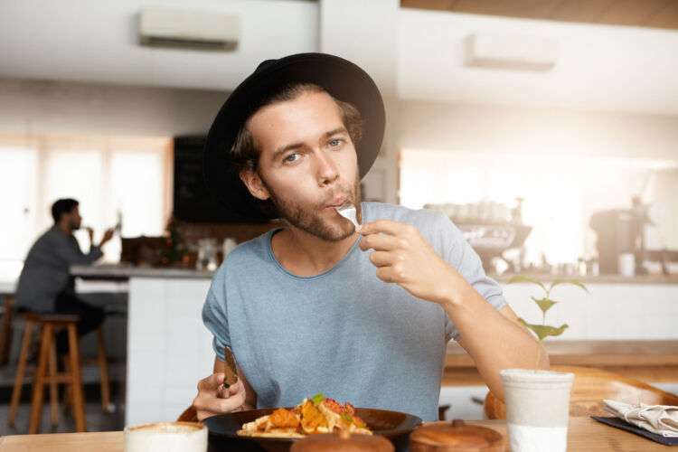Fashionable,Young,Man,Enjoying,Tasty,Food,For,Lunch,Sitting,At